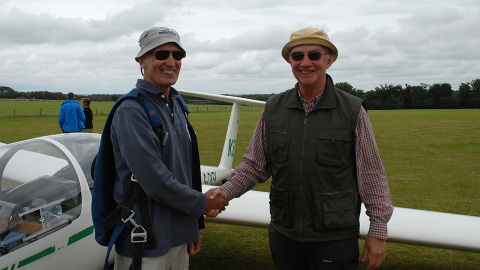 Chris (right) resolos in a glider